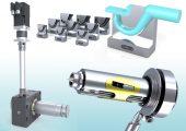 Tunnelanguss-Einsätze in größerer Vielfalt (oben), darunter die neue Heißkanaldüse 'Single Shot' und links eine servomotorische Antriebseinheit für Indexplatten. (Bildquelle: I-mold)