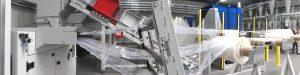 Den Mittelpunkt der dritten Zerkleinerungslinie im Aufbereitungszentrum von Pro-Pac bildet eine Einzugsmühle, die synchron PP-Folienreste unterschiedlicher Dicken zerkleinert. Die Zuführung erfolgt über eine dreiteilige, sensorgesteuerte Abrollvorrichtung.