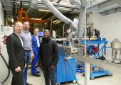 (v. l. n. r.) Peter von Hoffmann, General Manager Business Unit Engineering Plastics & Special Applications, Levin Batschauer, Sales Manager Special Applications, Markus Fiedler, Senior Process Engineer (alle Coperion) und David Romaric Tinkou von Asahel Benin vor der ZSK-Anlage im Technikum in Stuttgart. (Bildquelle: alle Coperion)