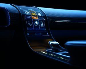 Gedruckte Elektronik im Auto: Animation eines geschwungenen Displays als Human Machine Interface. (Copyright: Leonhand Kurz/PolyIC)