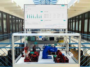 Modifizierter Demonstrator mit Fischertechnik Komponenten und mehreren industriellen Maschinensteuerungen sowie Industrieroboter, um Künstliche Intelligenz speziell zur Produktionsoptimierung erlebbar und verständlich zu machen. (Bildquelle: plus10)
