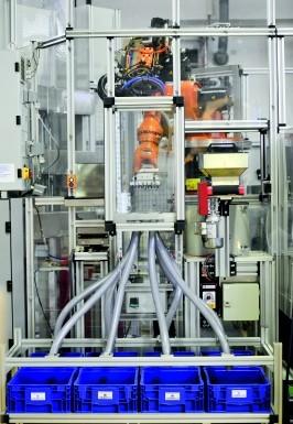 Ein Roboter trennt Gut- und Schlecht-Teile. (Bildquelle: Kistler)