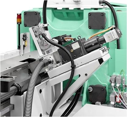 Spritzgießaggregat mit der Einheit zum direkten Einarbeiten von Fasern. (Bildquelle: SKZ/Arburg)